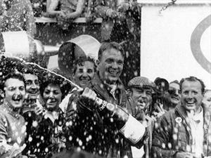 ¿De donde viene la tradición de rociar Champagne en el podio?